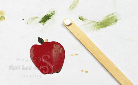 012 Adhere One Apple To Stirring Stick- Keri Lee Sereika