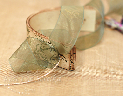 13 Pull the strips to a U shape and tie a length of Organdy ribbon through a knot at the top of the ornament - Keri Lee Sereika